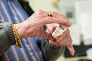 Gerry Reichelderfer, an 81-year-old pharmacist from Hayfork, Calif., works five days per week filling prescriptions at his pharmacy (Photo by Heidi de Marco/KHN).